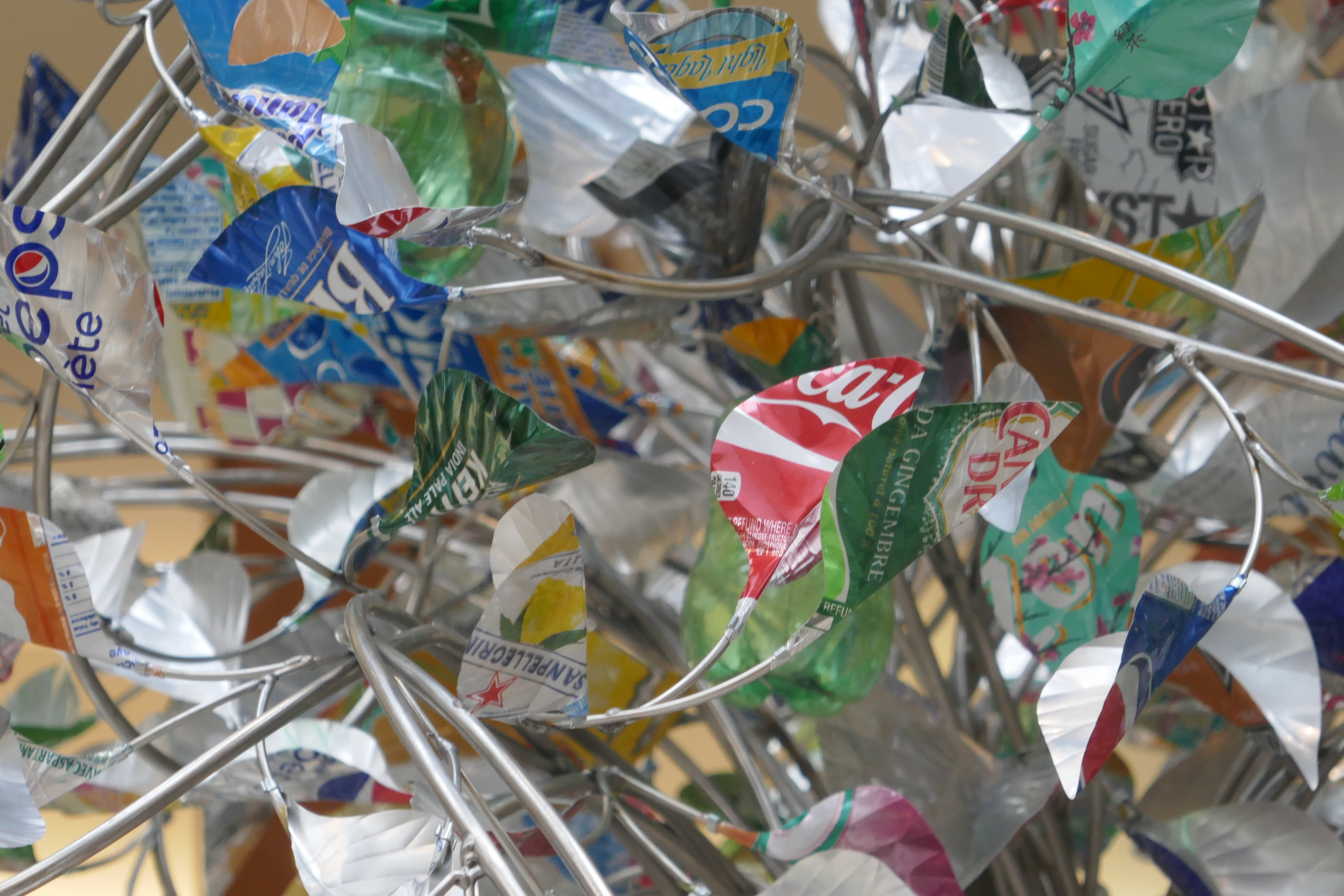 Local artists craft one-of-a-kind piece using recycled containers.