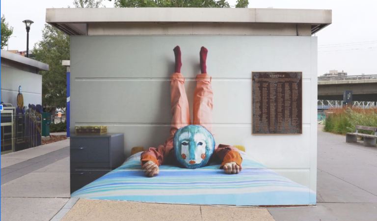 New East Village art installation tells local stories through touching and yes, slightly creepy images.